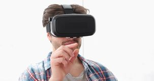 Young man using virtual reality simulator stock footage
