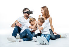 Man in virtual reality headset with family. On white background Stock Photography