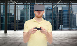 Man in virtual reality headset with gamepad Stock Photos