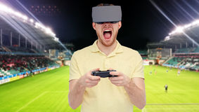 Man in virtual reality headset over football field Stock Photos