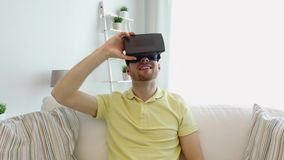 Man in virtual reality headset playing game stock footage