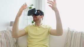 Man in virtual reality headset playing game stock video