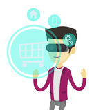 Man in virtual reality headset shopping online. Stock Photo