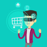Man in virtual reality headset shopping online. Stock Image