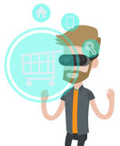 Man in virtual reality headset shopping online. Royalty Free Stock Photography