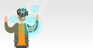 Man in virtual reality headset shopping online. Royalty Free Stock Image