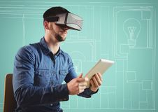 Man in virtual reality headset with tablet against aqua and white hand drawn office. Digital composite of Man in virtual reality headset with tablet against aqua Stock Photos