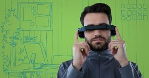 Man in virtual reality headset with tablet against blue and green hand drawn office. Digital composite of Man in virtual reality headset with tablet against blue stock images