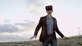 A man in virtual realty headset. In the countryside stock footage