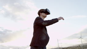 A man in virtual realty headset. Doing some moves in the countryside stock video footage