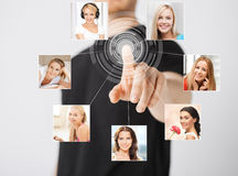 Man with virtual screen and contact icons Royalty Free Stock Images