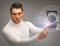 Man with virtual tablet pc Royalty Free Stock Image