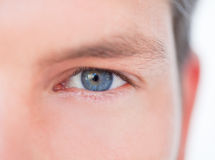 Man vision. Male blue eye in close-up as symbol concept of successful business vision Royalty Free Stock Photos