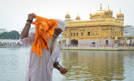 A man visit the Golden temple in Amritsar, India. People visit the Golden temple in Amritsar, north of India. Amritsar (also called Ambarsar) is a city in the royalty free stock images