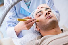 The man visiting dermatologyst for laser scar removal. Man visiting dermatologyst for laser scar removal stock photo