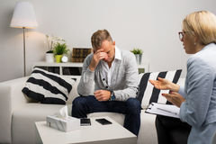 Man visiting doctors office for therapy stock photography