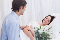 Man visiting his girlfriend in the hospital Stock Photography