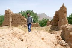 Man visiting a historical ruins site royalty free stock image