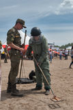Man - visitor of show tries on the sapper suit Stock Image