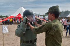 Man - visitor of show tries on the sapper suit Stock Photo