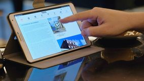 Man visits Air France airlines company site site using tablet pc in cafe. Paris - February 15, 2017: Man visits Air France airlines company site site using stock video footage