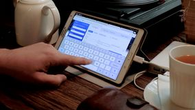 Man visits american airlines company site using tablet pc in caf stock footage