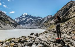 Man visits Mount cook, New Zealand. Young tourist photographing royalty free stock photo