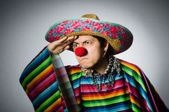 Man in vivid mexican poncho against gray Stock Images