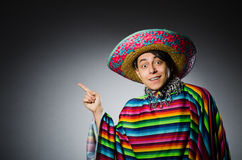 Man in vivid mexican poncho against gray Royalty Free Stock Photos