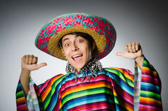 Man in vivid mexican poncho against gray Stock Image