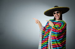 The man in a vivid mexican poncho gray background isolated Royalty Free Stock Photos