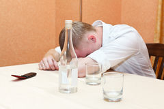 Man and vodka Stock Images