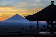 Man with and Volcano Agung as Background. Royalty Free Stock Photo