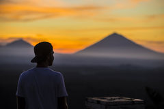 Man and Volcano Agung as Background. Royalty Free Stock Photography