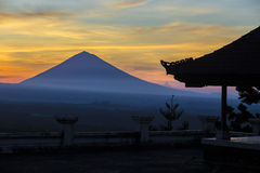 Man with and Volcano Agung as Background. Royalty Free Stock Photography
