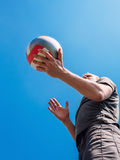 Man on volleyball service with blue sky Stock Photos