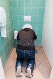 Man vomiting in the toilet Royalty Free Stock Image
