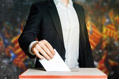 Man Voter Putting A Ballot Into A Voting box. Democracy Freedom Concept Royalty Free Stock Photography