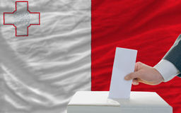 Man voting on elections in malta Royalty Free Stock Image