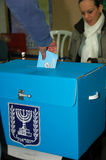 Man voting in Israeli elections. A man puts an envelope with his vote in the ballot box in Israels elections 2009 Royalty Free Stock Photography
