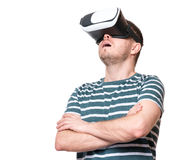 Man in VR glasses. Amazed man wearing virtual reality goggles watching movies or playing video games, isolated on white background. Surprised male in VR glasses Royalty Free Stock Photos