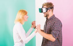 Man VR glasses enjoy video game. Best gift ever. Man enjoy virtual reality. Girl happy he like her gift. Gift ideas for. Men. Make him happy gift him virtual royalty free stock images