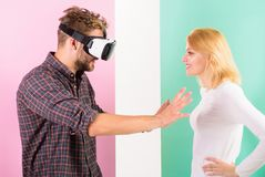 Man VR glasses going touch breasts virtual girl. Cyber relations instead real. Virtual reality pleasures. Virtual sex. Concept. Guy vr glasses interact in cyber stock photo