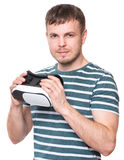 Man in VR glasses. Handsome man wearing virtual reality goggles watching movies or playing video games. Male with in VR glasses looking at camera, isolated on Stock Images