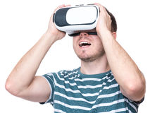 Man in VR glasses. Happy man wearing virtual reality goggles watching movies or playing video games - closeup. Cheerful smiling male looking in VR glasses Royalty Free Stock Photos