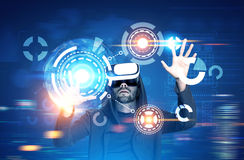 Man in VR glasses, HUD, blurred blue Stock Photo