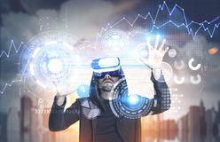 Man in VR glasses, HUD, graphs, city Royalty Free Stock Images