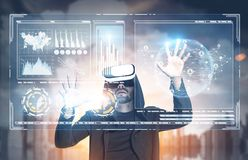 Man in VR glasses, HUD, infographics, city Royalty Free Stock Image