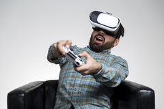 Man in vr glasses impressed by a game Stock Photography