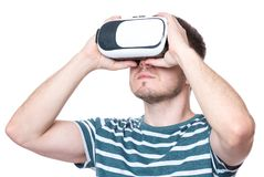 Man with VR glasses. Man wearing virtual reality goggles watching movies or playing video games - closeup. Male looking in VR glasses, isolated on white Stock Image